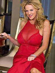 Kelly in slinky red dress gets naked and shows...